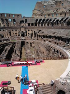 A crew works to partially rebuild the stage in the Colosseum